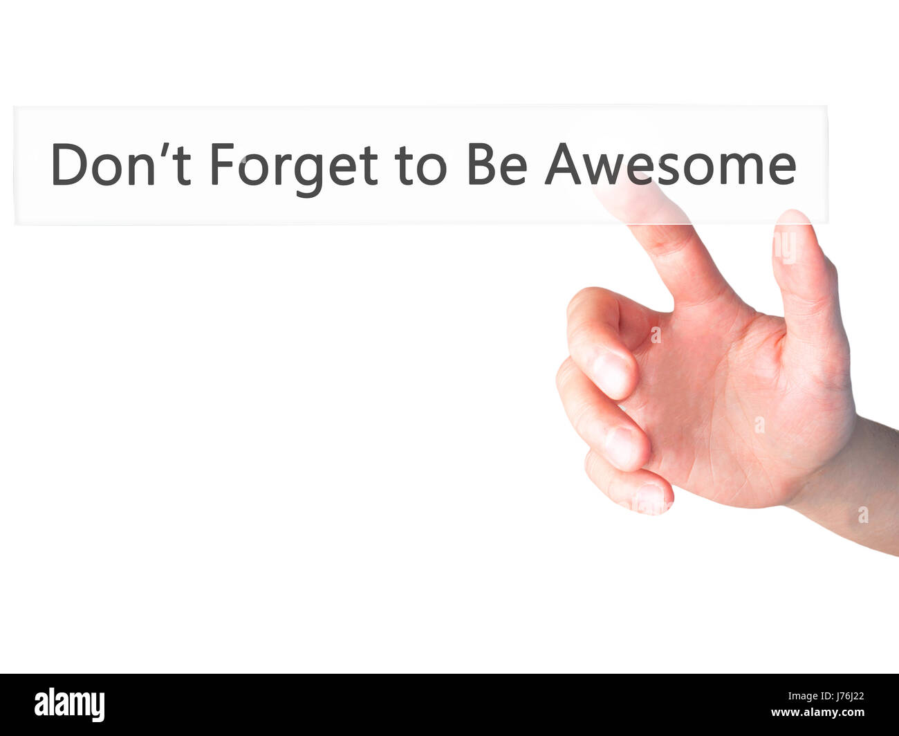Don't Forget to Be Awesome - Hand pressing a button on blurred background concept . Business, technology, internet - Stock Image