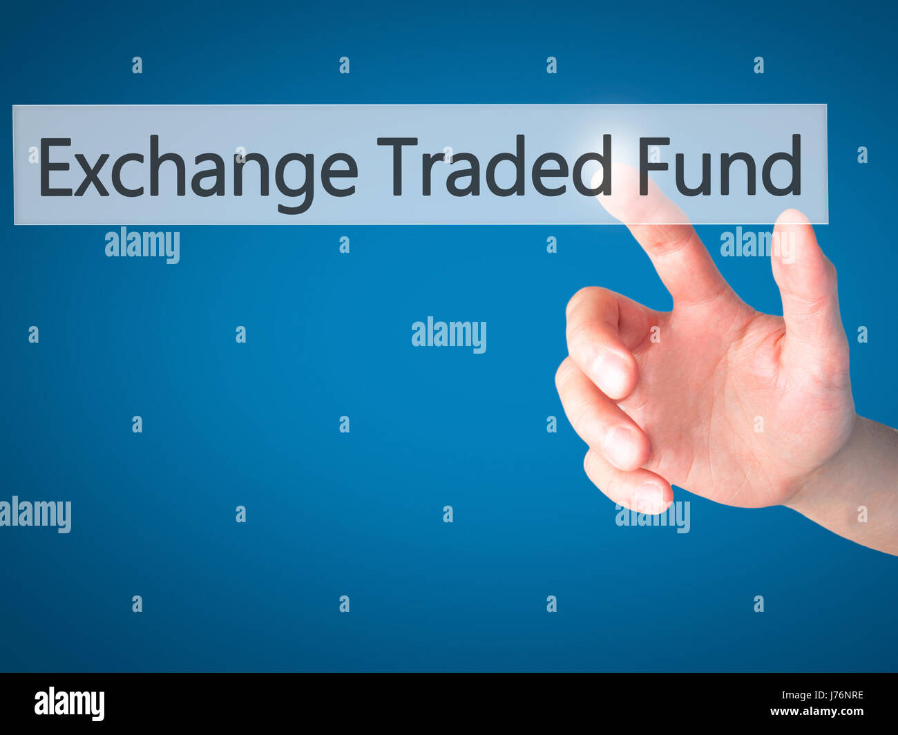 Exchange Traded Fund - Hand pressing a button on blurred background concept . Business, technology, internet concept. Stock Photo