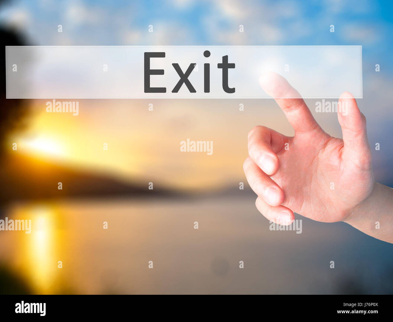 Exit - Hand pressing a button on blurred background concept . Business, technology, internet concept. Stock Photo - Stock Image