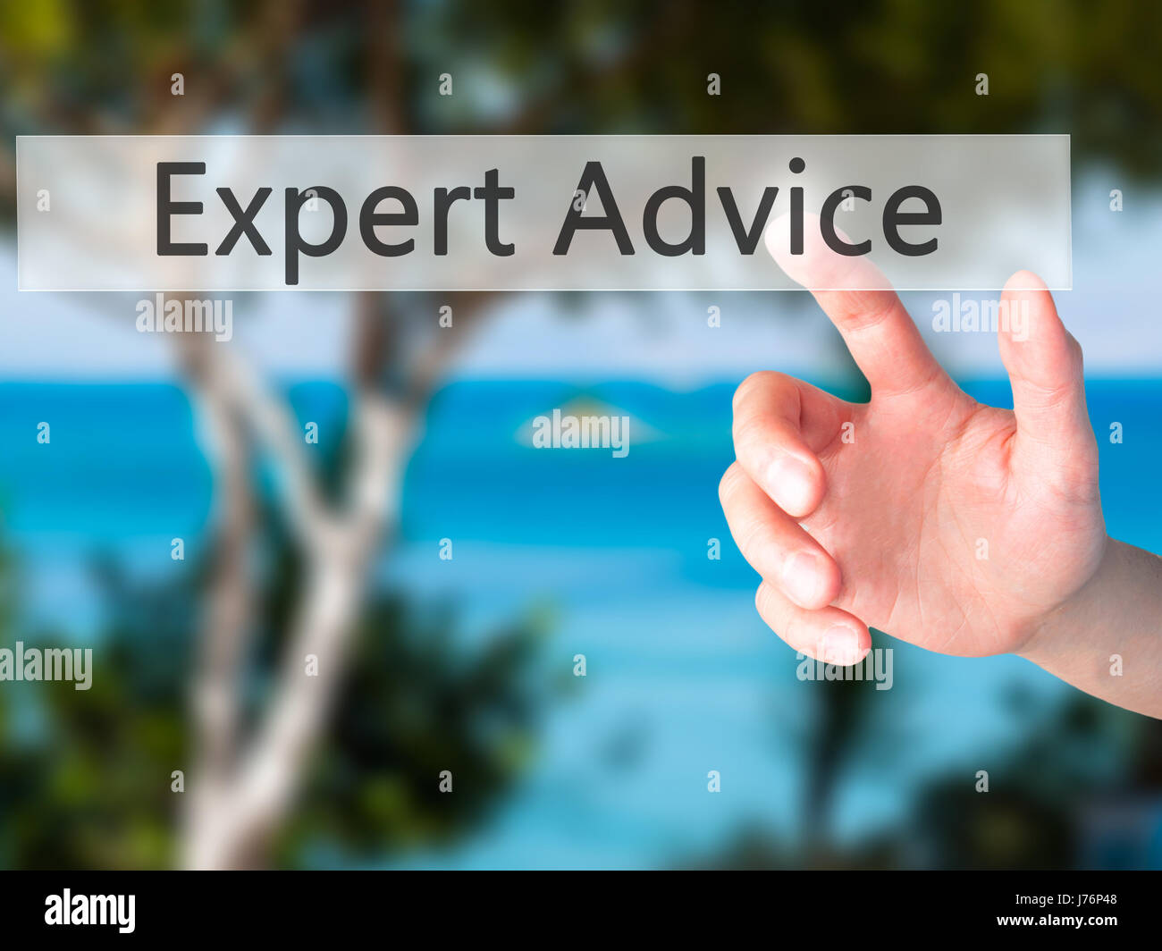Expert-Advice - Hand pressing a button on blurred background