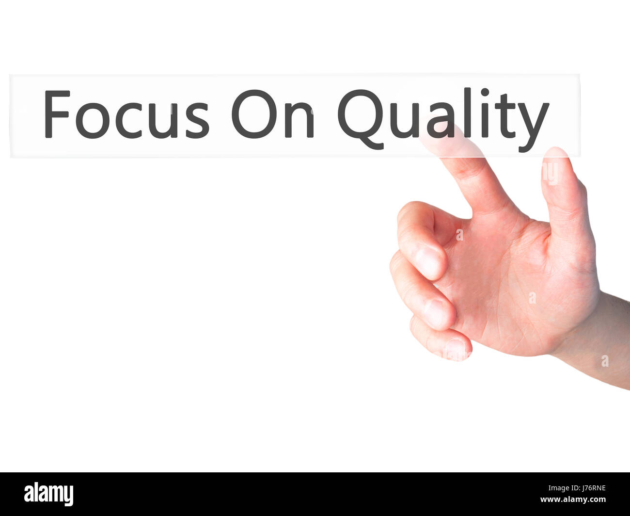 Focus On Quality - Hand pressing a button on blurred background concept . Business, technology, internet concept. - Stock Image