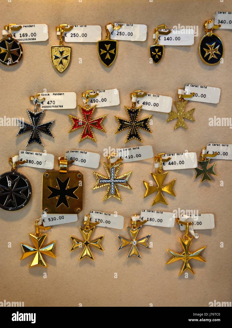 Gold maltese cross pendants for sale in a shop along republic street gold maltese cross pendants for sale in a shop along republic street aka triq ir repubblika valletta malta europe mozeypictures Image collections