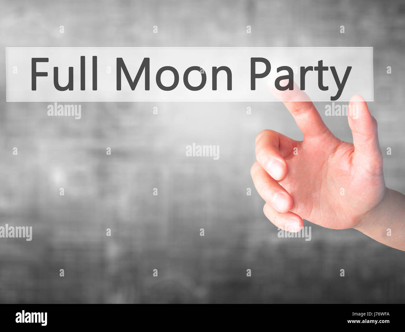 Full Moon Party - Hand pressing a button on blurred background concept . Business, technology, internet concept. - Stock Image