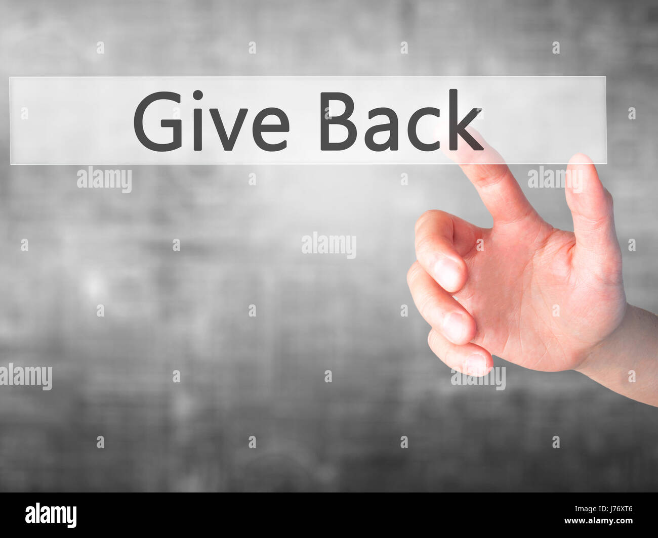 Give Back - Hand pressing a button on blurred background concept . Business, technology, internet concept. Stock - Stock Image
