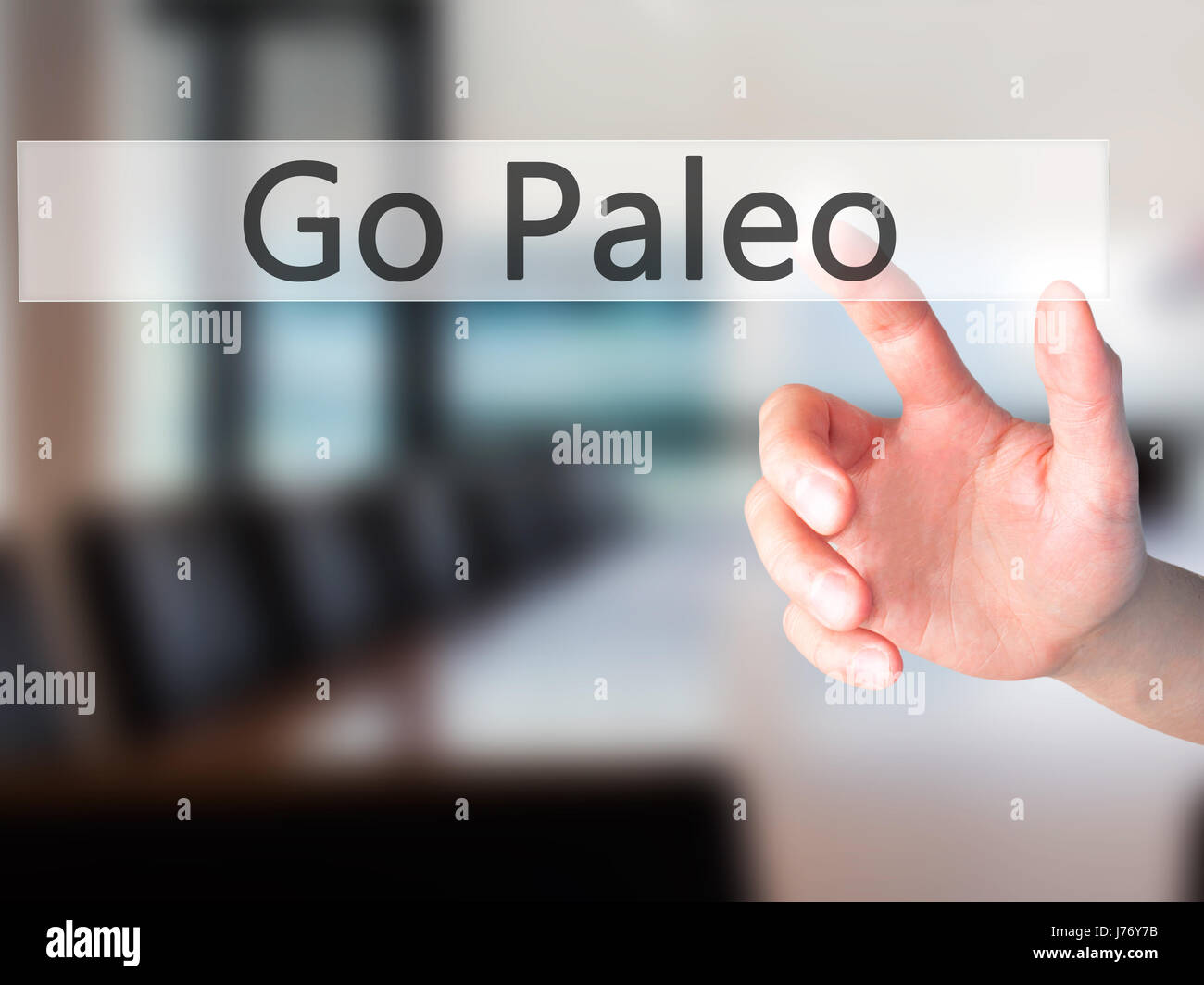 Go Paleo - Hand pressing a button on blurred background concept . Business, technology, internet concept. Stock - Stock Image