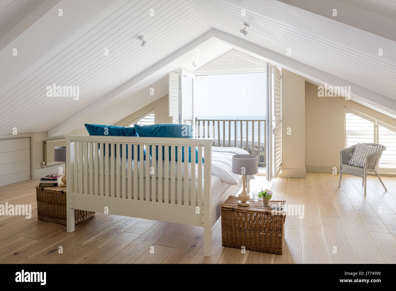 Feather Black Bed In Top Floor Master Bedroom With Pitched Ceiling Stock Photo Alamy