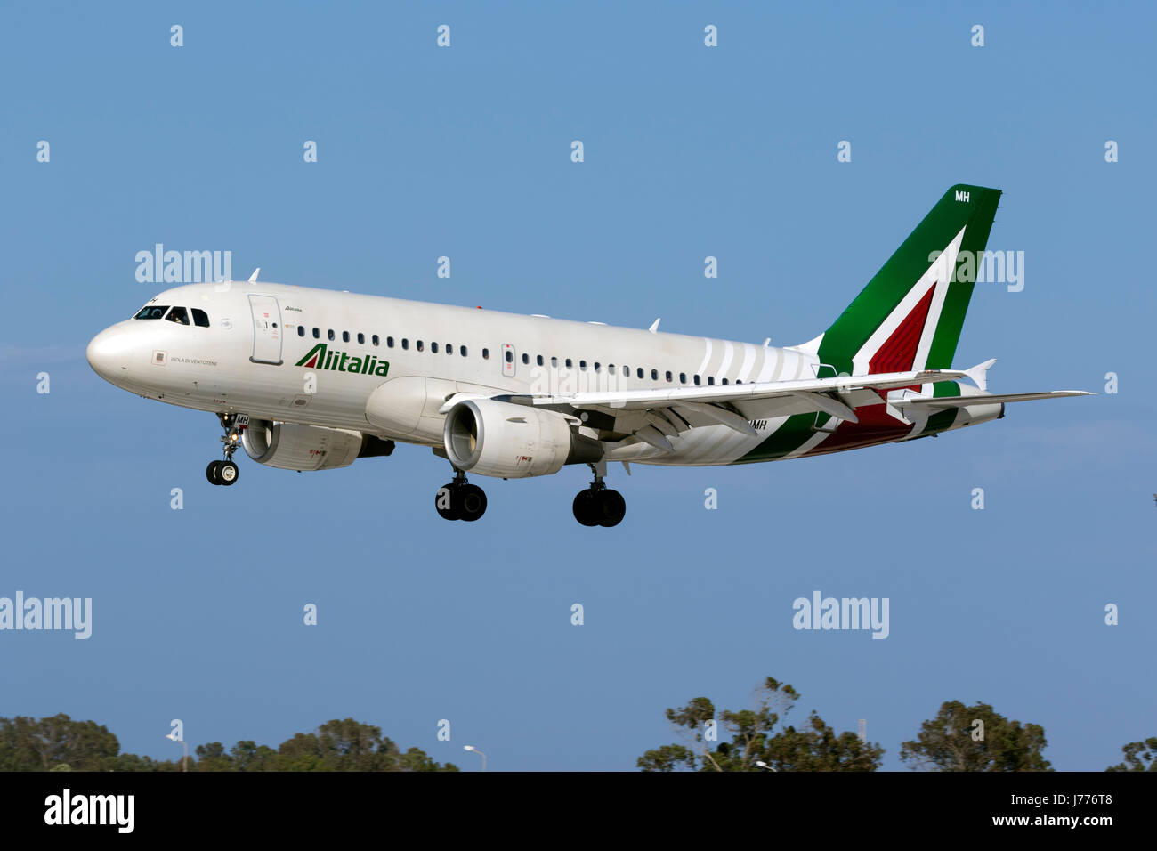Alitalia Airbus A319-112 [EI-IMH] in the latest livery for Alitalia landing runway 31. Stock Photo