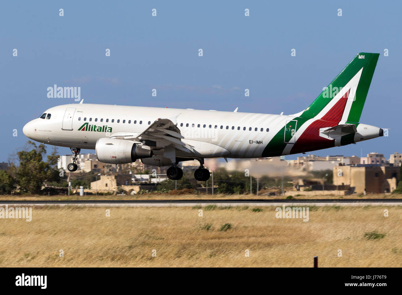 Alitalia Airbus A319-112 [EI-IMH] in the latest livery for Alitalia landing runway 31. - Stock Image
