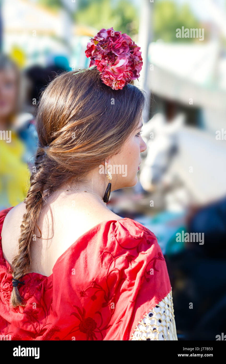 Seville, Spain - May 02, 2017: Beautiful woman wearing flamenco dress at the Seville's April Fair. - Stock Image