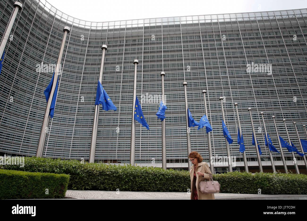 Brussels, Belgium. 23rd May, 2017. European Union flags are lowered to half mast outside the European Commission - Stock Image