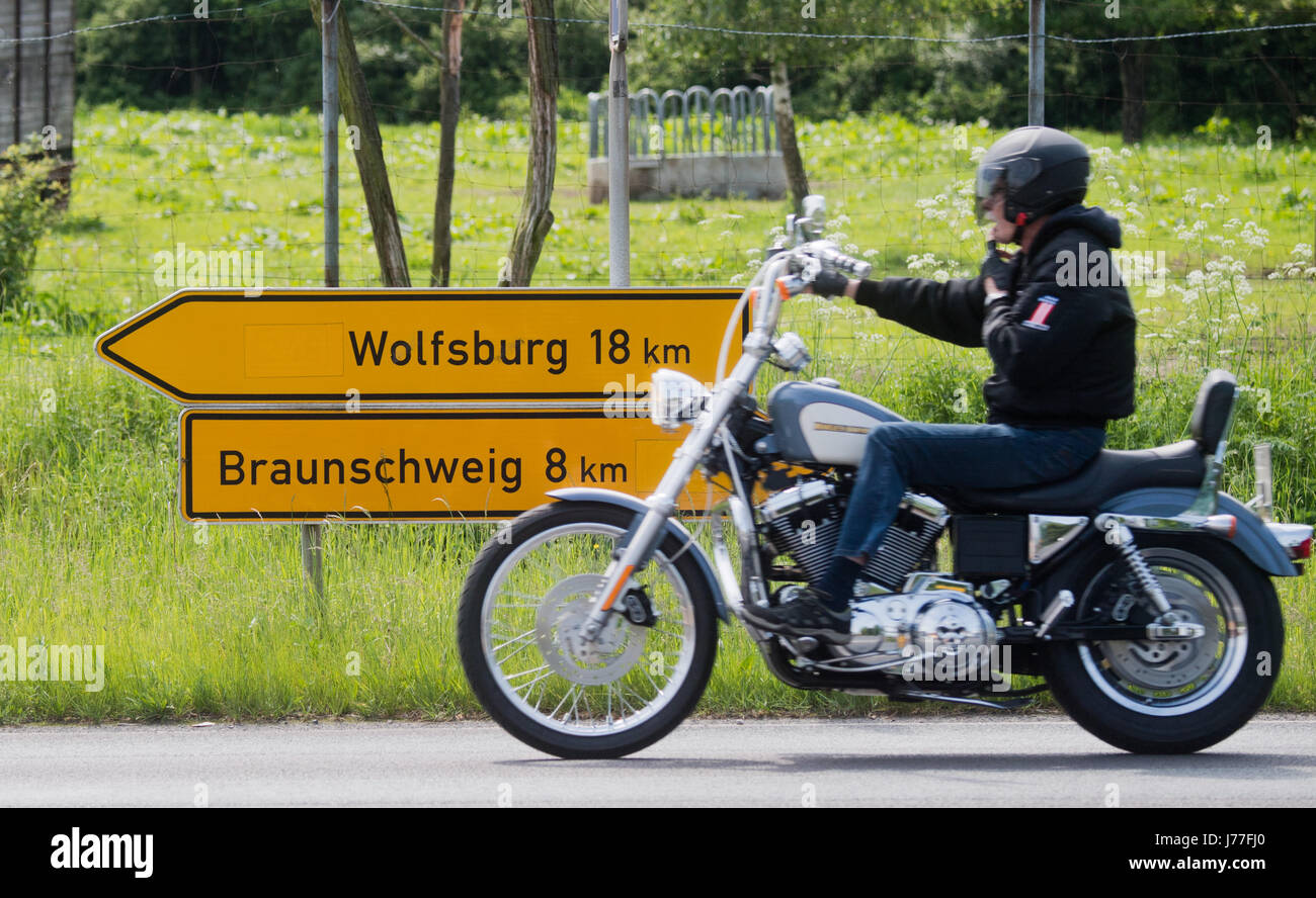 Traffic signs point the way to Wolfsburg and Braunschweig, Lower Saxony, along a Federal Highway between the two - Stock Image
