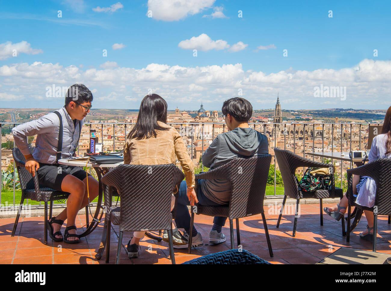 Japanese tourists at the viewpoint. Parador, Toledo, Castilla La Mancha, Spain. - Stock Image