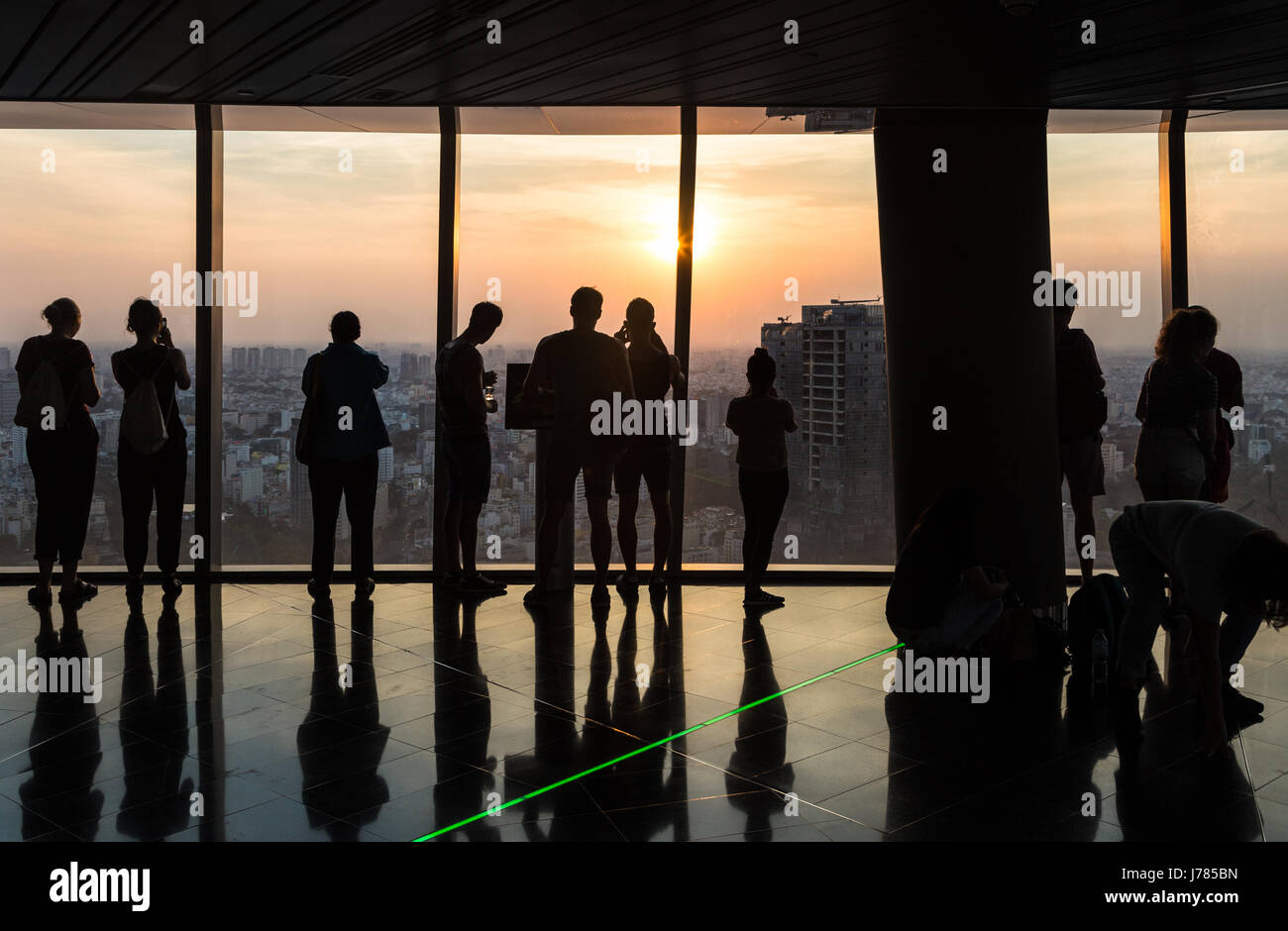 HO CHI MINH CITY, VIETNAM - APRIL 15: Tourists enjoy the view from an observatory in a tall building in Ho Chi Minh - Stock Image