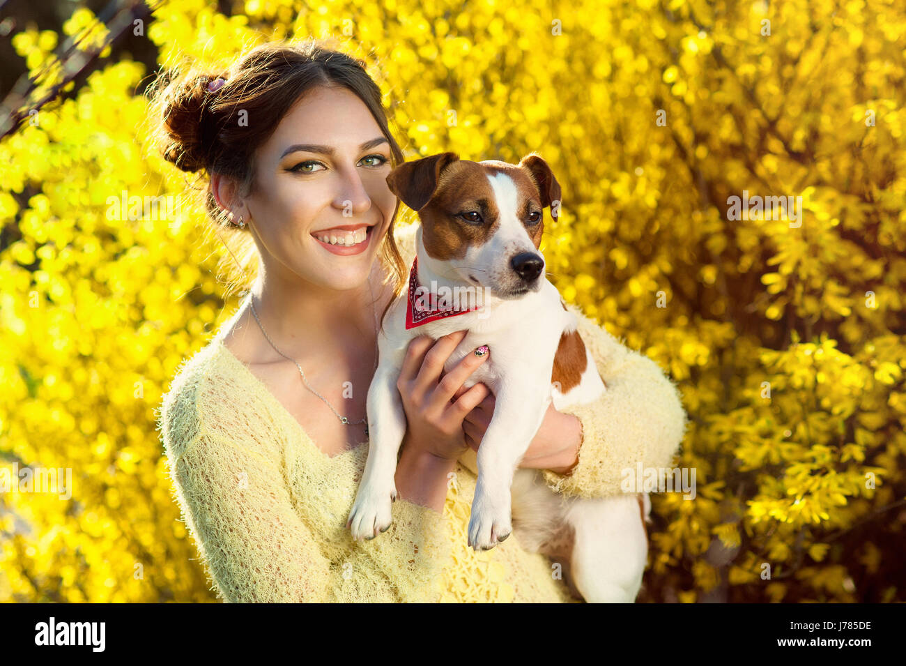 Beautiful woman playing with her dog. Outdoor portrait. series - Stock Image