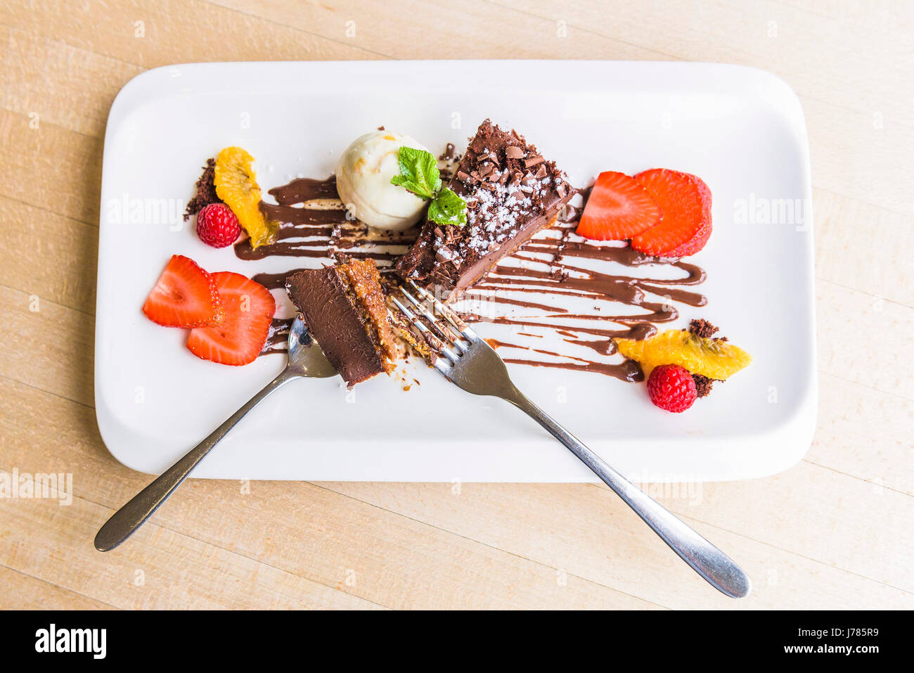 An overhead view of Chocolate Delice with vanilla ice cream; Pudding; Sweet; Food; Indulgence; Luxury; Luxurious; - Stock Image