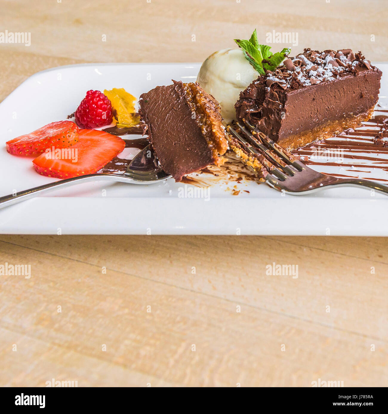 Chocolate Delice with vanilla ice cream; Pudding; Sweet; Restaurant interior; Food; Indulgence; Luxury; Luxurious; - Stock Image