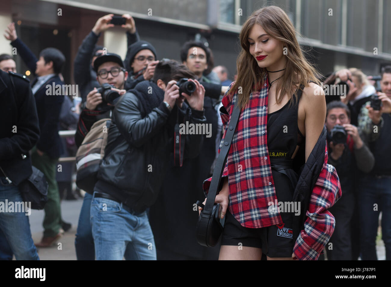 Model Grace Elizabeth surrounded by photographers after Dolce and Gabbana show during the Milan Fashion Week Fall/Winter - Stock Image