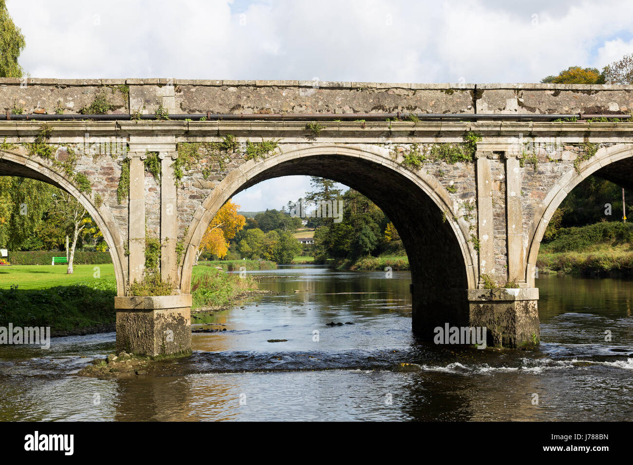 The historic and beautiful Ten Arch stone Bridge over River Nore in Inistioge, Kilkenny, Ireland photographed in - Stock Image