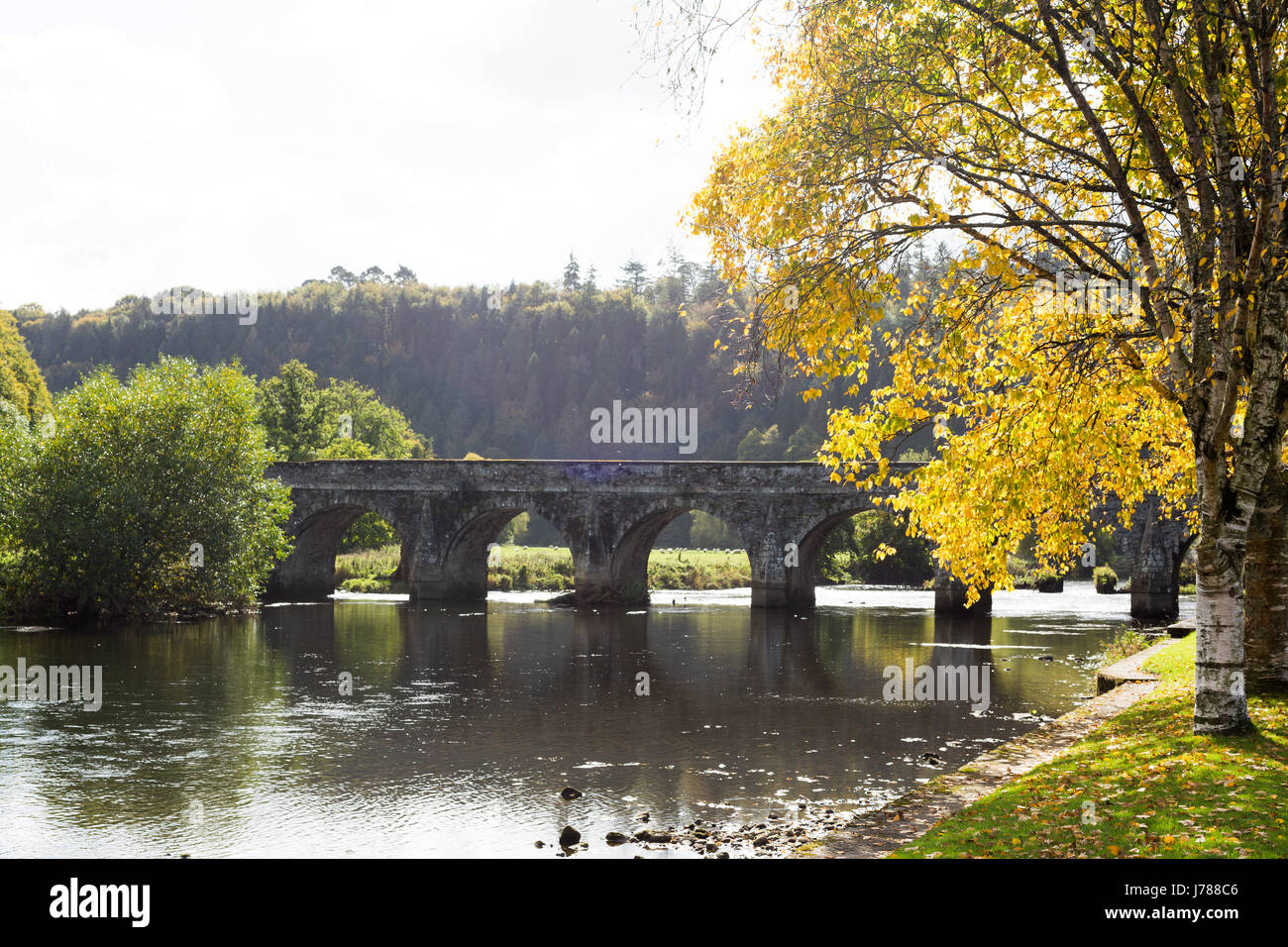 The historic and beautiful Ten Arch stone Bridge over River Nore in Inistioge, Kilkenny, Ireland - Stock Image