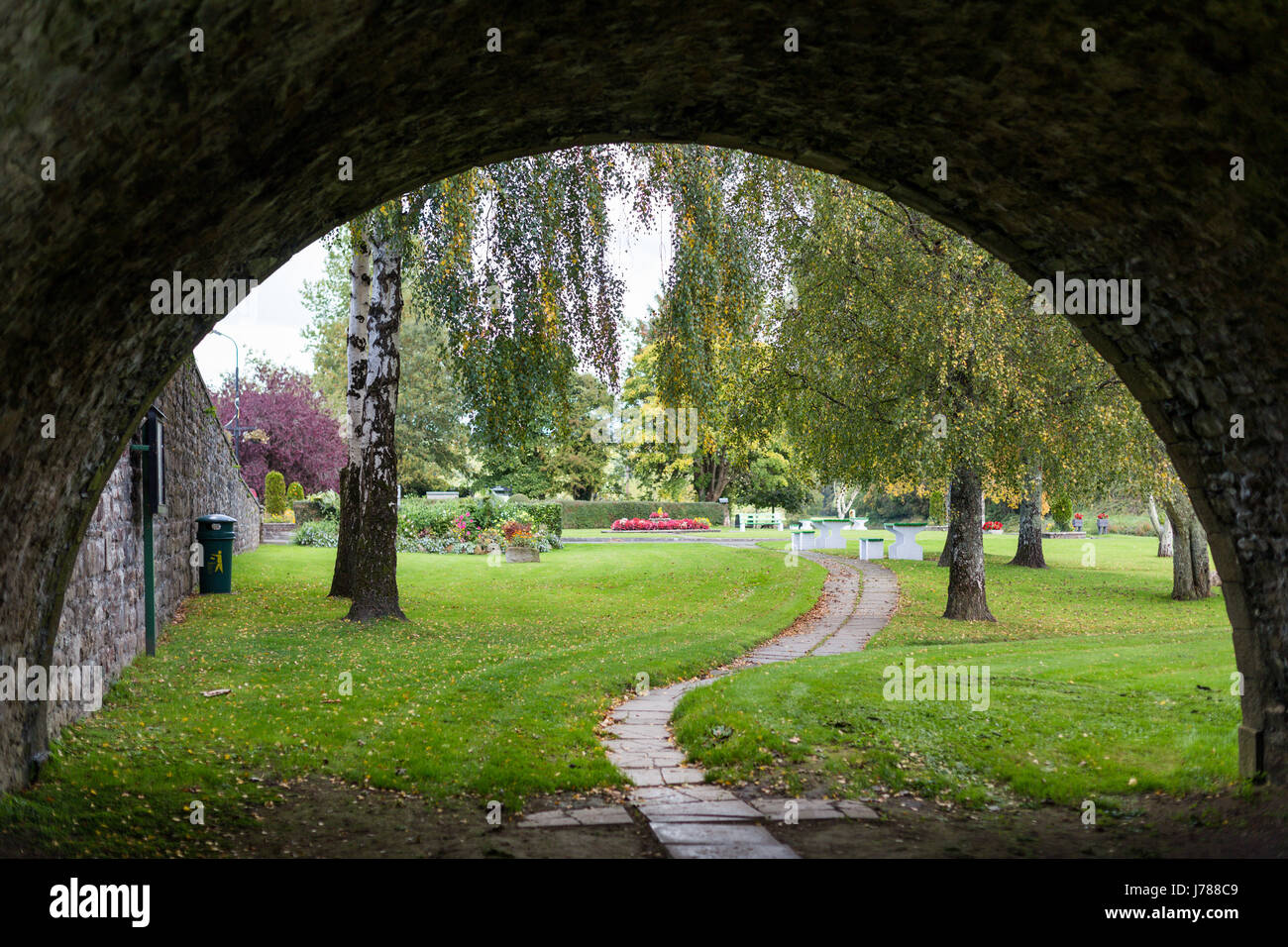 Walking through The historic and beautiful Ten Arch stone Bridge over River Nore in Inistioge, Kilkenny, Ireland - Stock Image