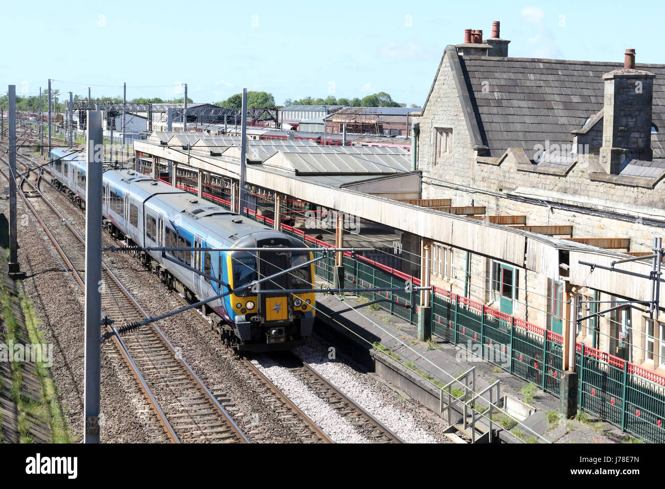 Siemens Desiro class 350 electric multiple unit, number 350404, passing through Carnforth on the WCML with a Manchester - Stock Image