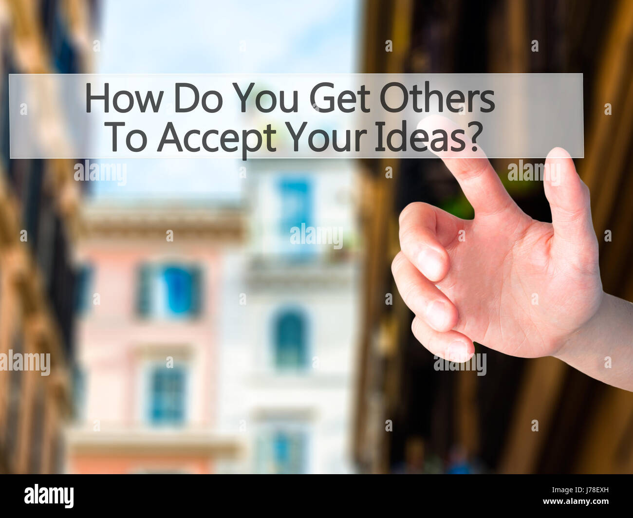 How Do You Get Others To Accept Your Ideas - Hand pressing a button on blurred background concept . Business, technology, - Stock Image