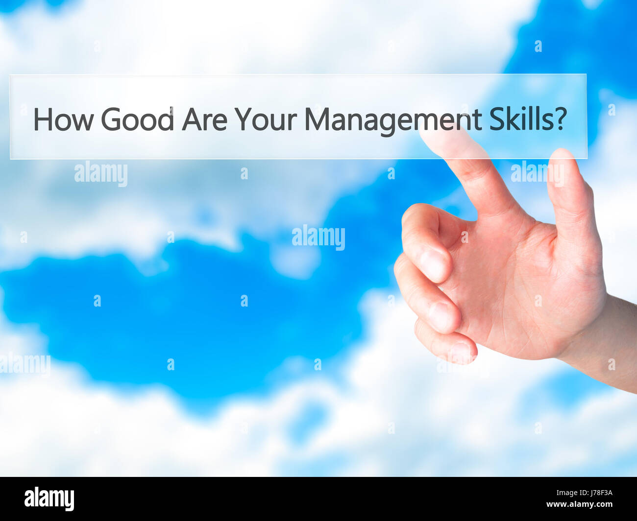 How Good Are Your Management Skills - Hand pressing a button on blurred background concept . Business, technology, - Stock Image