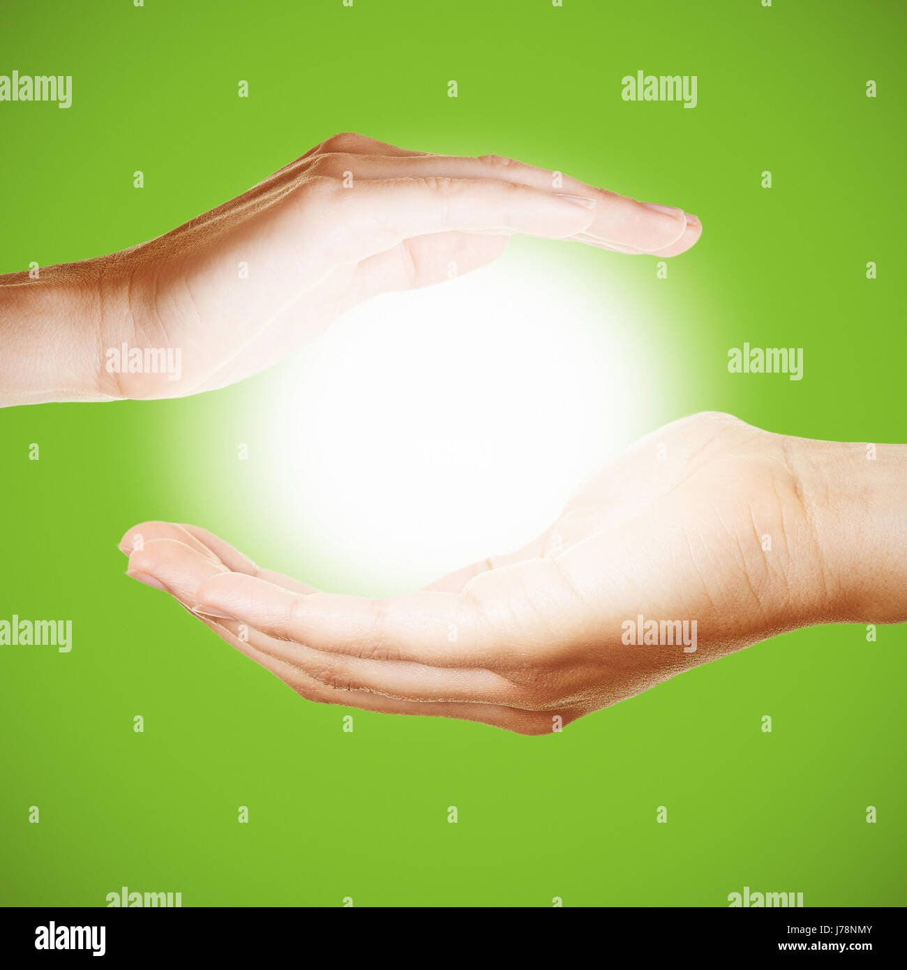 Two Hands Hold A Glowing Light Or Sun As Symbol For Meditation Or