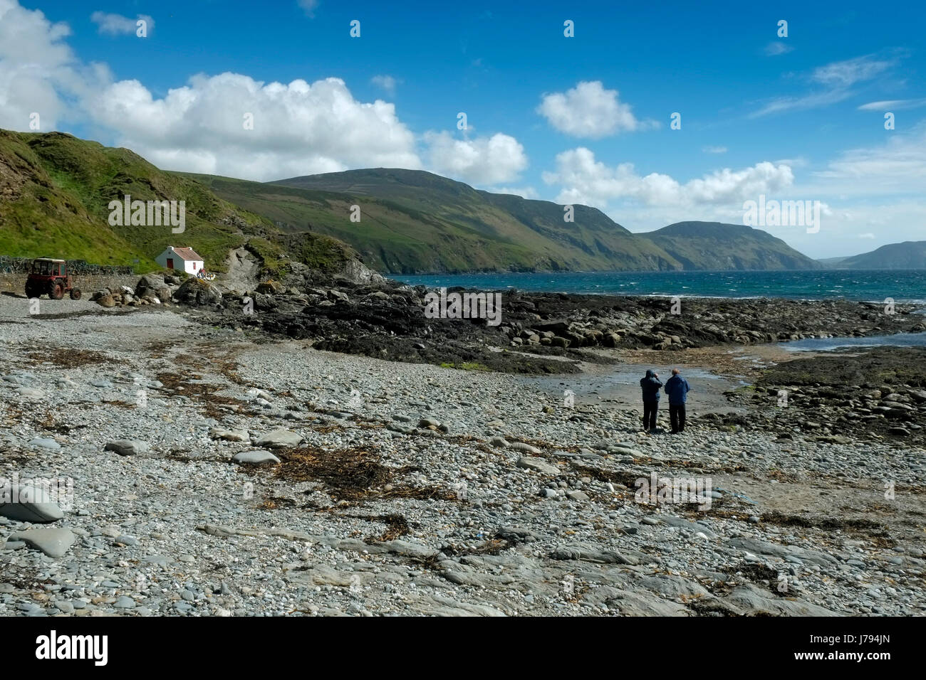 Niarbyl, Isle of Man, showing the beach, bay, row of cottages and a fisherman's hut, used for the filming of - Stock Image
