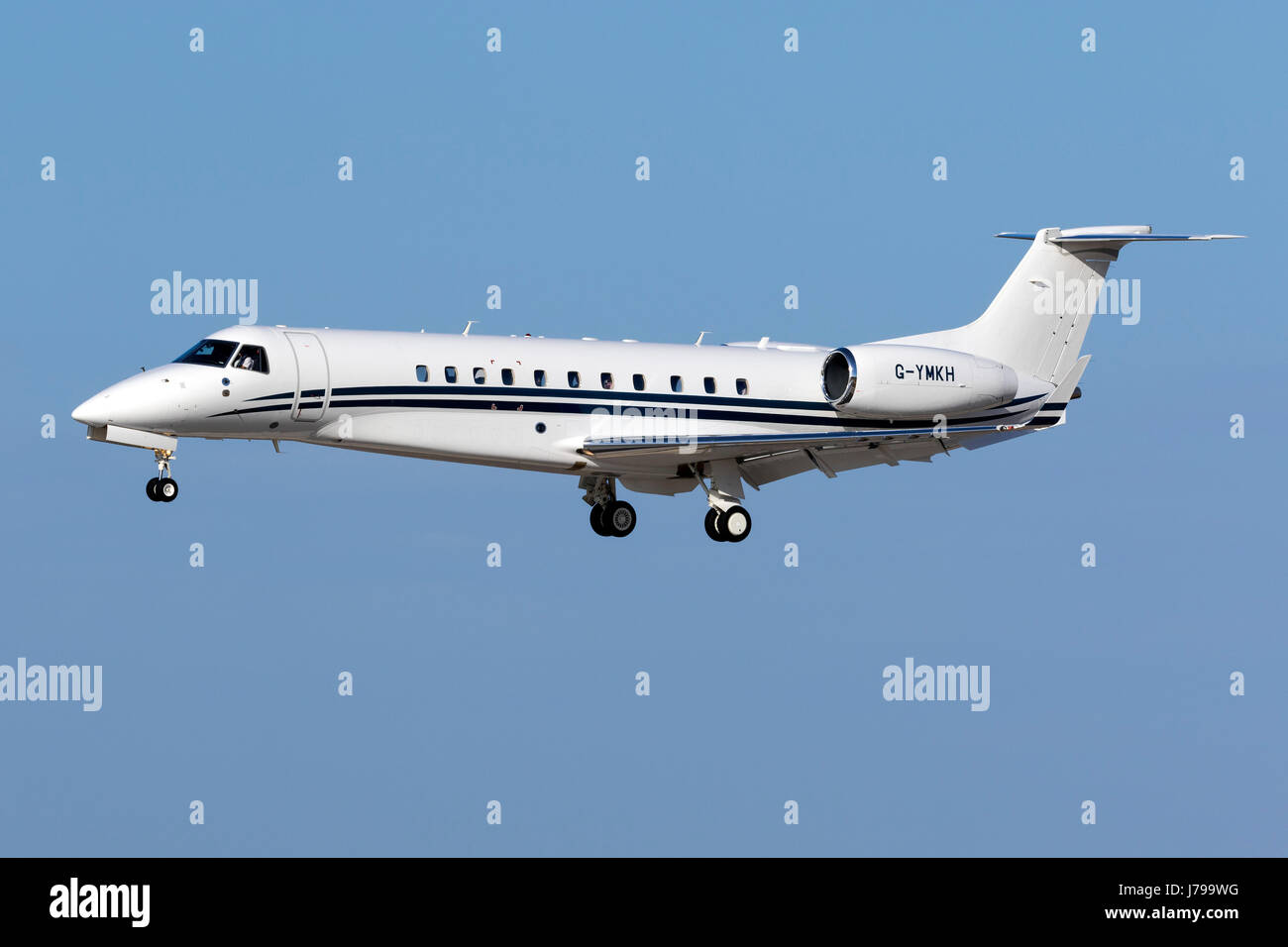 Tag Aviation Embraer EMB-135BJ Legacy 650 [G-YMKH] seconds before landing runway 31. - Stock Image