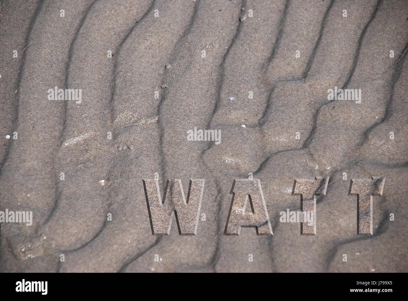 letters written writing font typography watt low tide grooves salt water sea - Stock Image