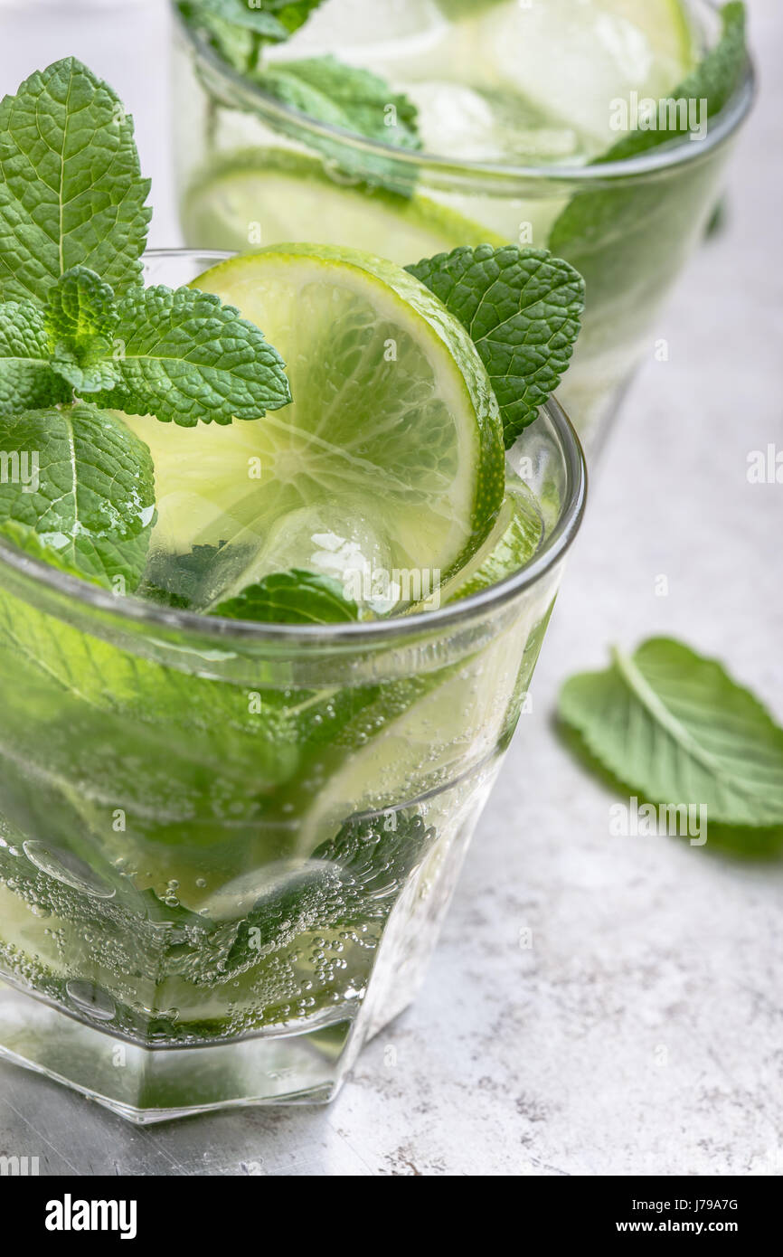 Mojito cocktail on light gray background close up, refreshing summer drink Stock Photo