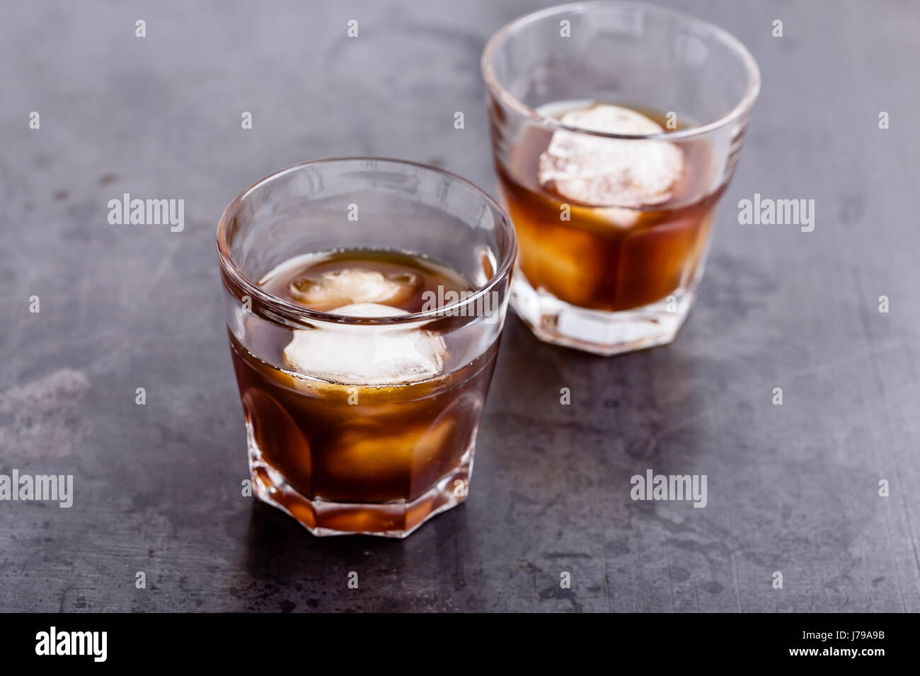 Cold brew coffee on rustic gray table, simple summer iced drink - Stock Image