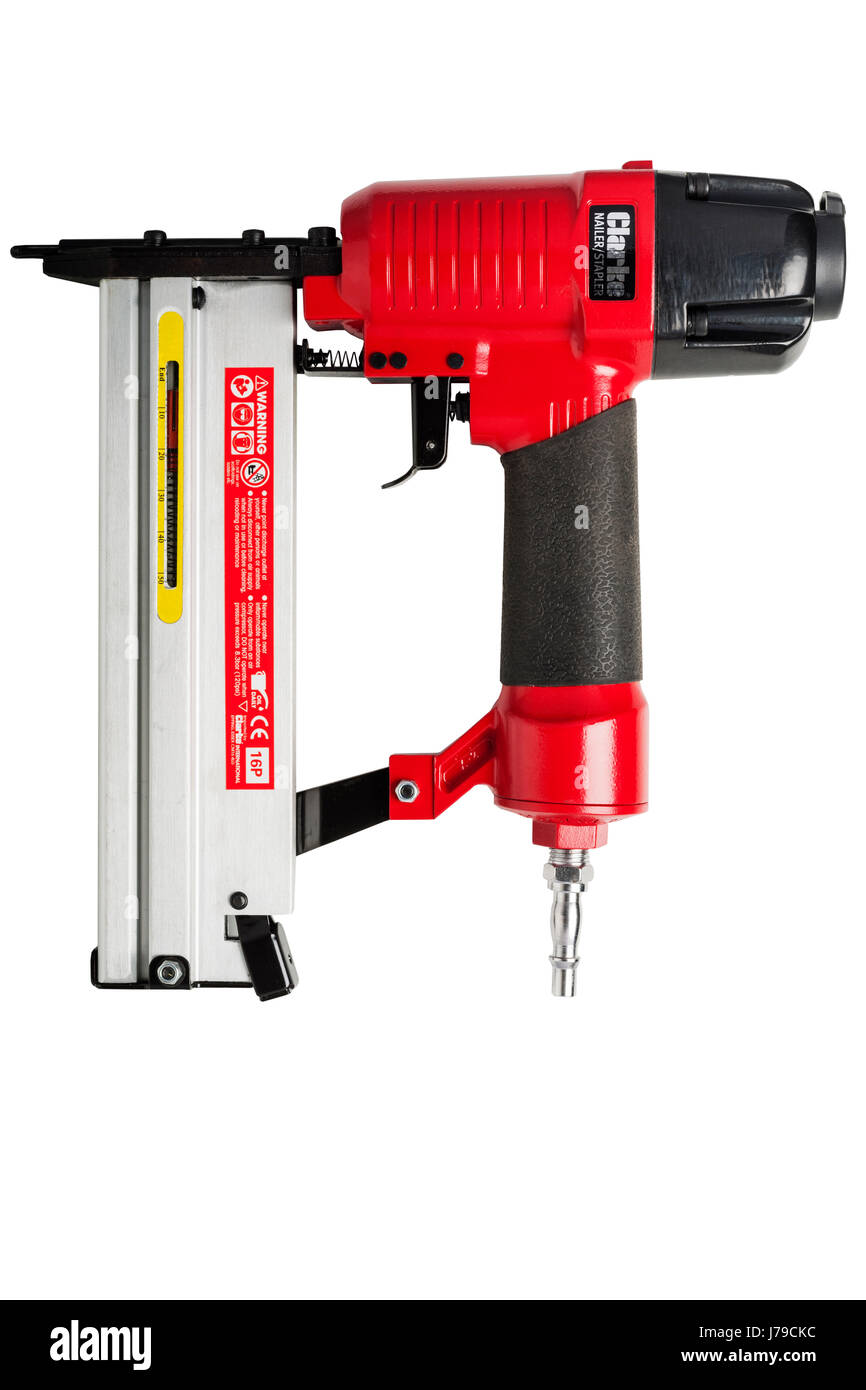 A nailgun & stapler powered by compressed air on a white background - Stock Image