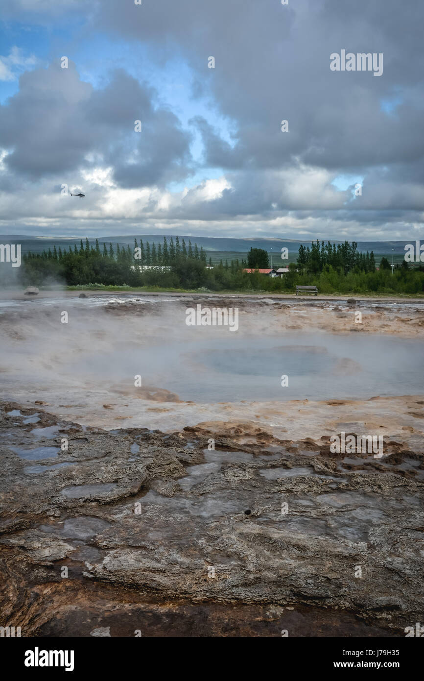 Strokkur geyser waiting to erupt in Iceland in summer - close-up - Stock Image