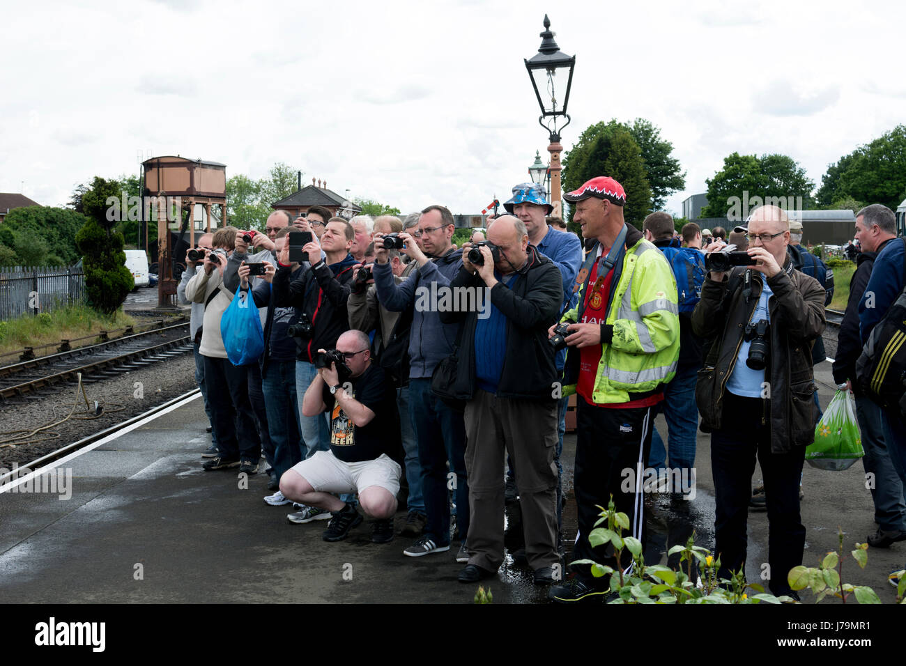 Rail enthusiasts taking photographs at the Spring Diesel Festival at the Severn Valley Railway, Kidderminster station, - Stock Image