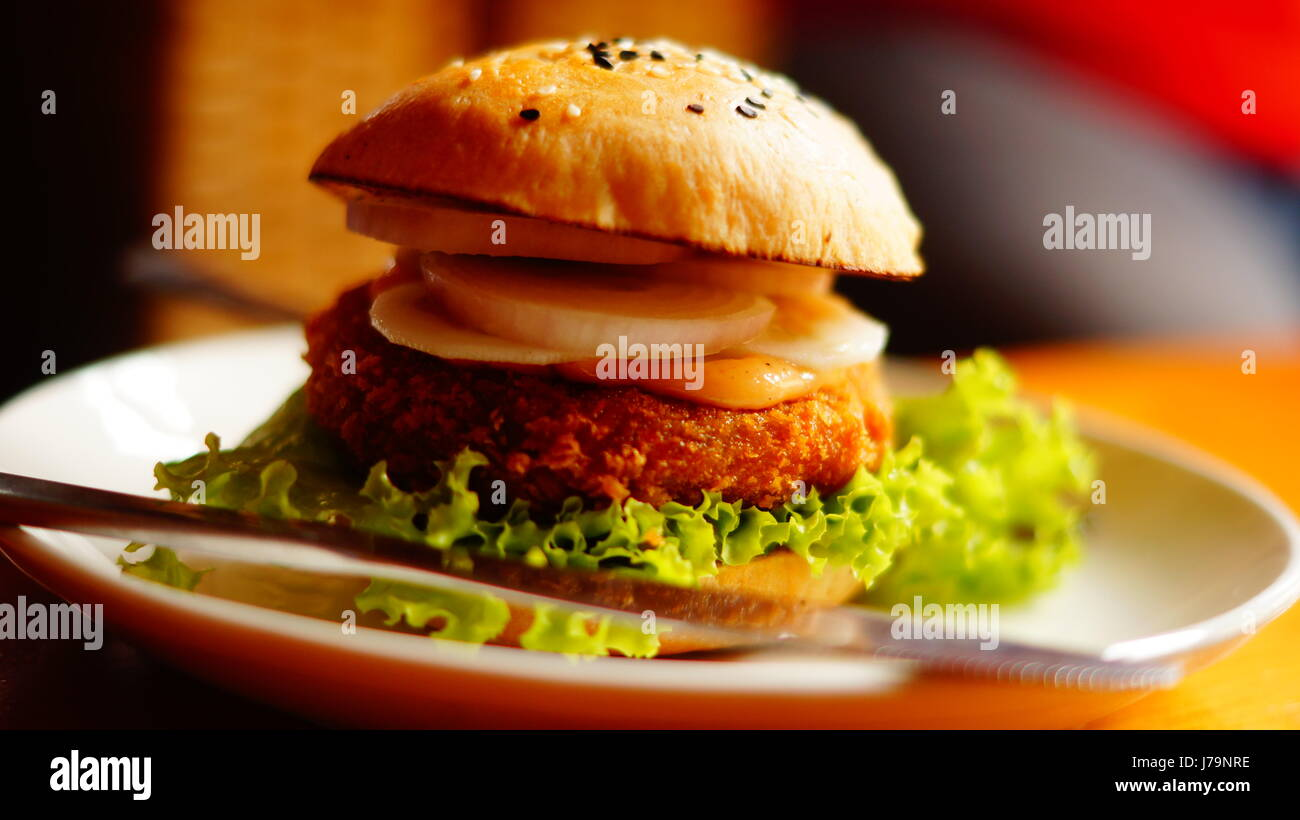A veg-burger at Chamapca Cafe, Paro. The burger was a treat to watch and eat. - Stock Image