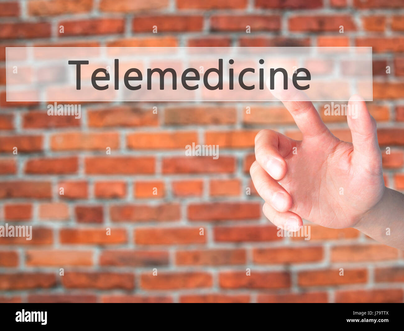 Telemedicine - Hand pressing a button on blurred background concept . Business, technology, internet concept. Stock - Stock Image