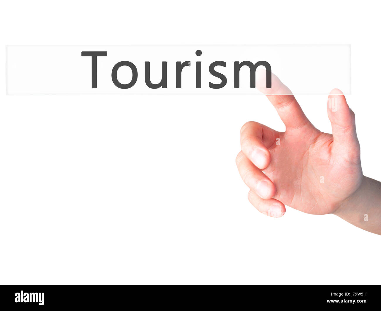 Tourism - Hand pressing a button on blurred background concept . Business, technology, internet concept. Stock Photo - Stock Image
