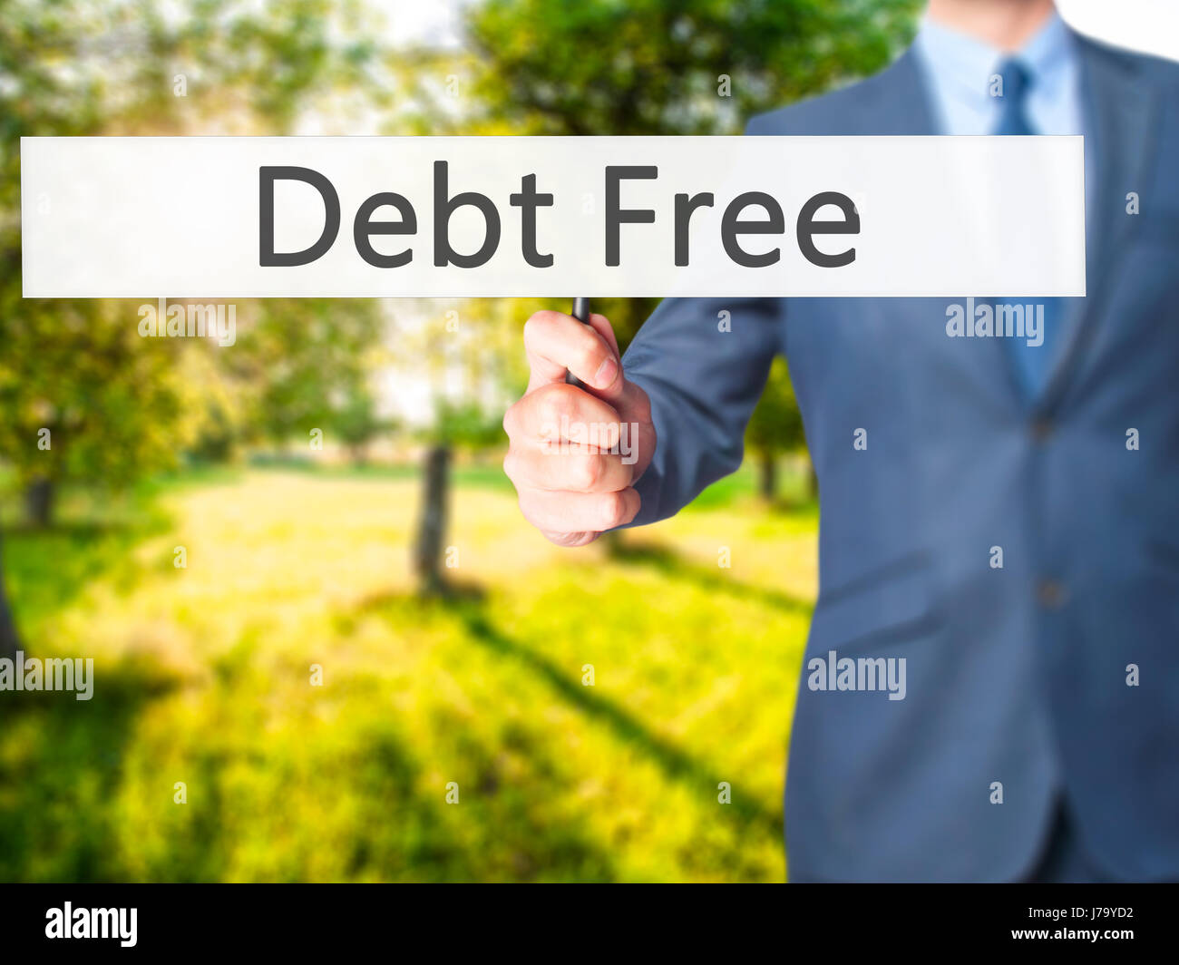 Debt Free - Businessman hand holding sign. Business, technology, internet concept. Stock Photo - Stock Image