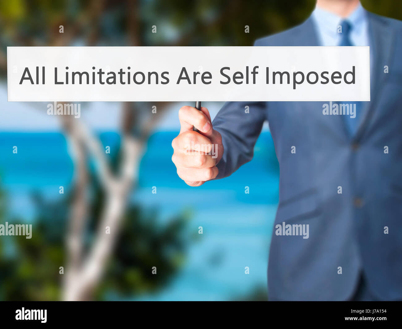 All Limitations Are Self Imposed - Businessman hand holding sign. Business, technology, internet concept. Stock - Stock Image
