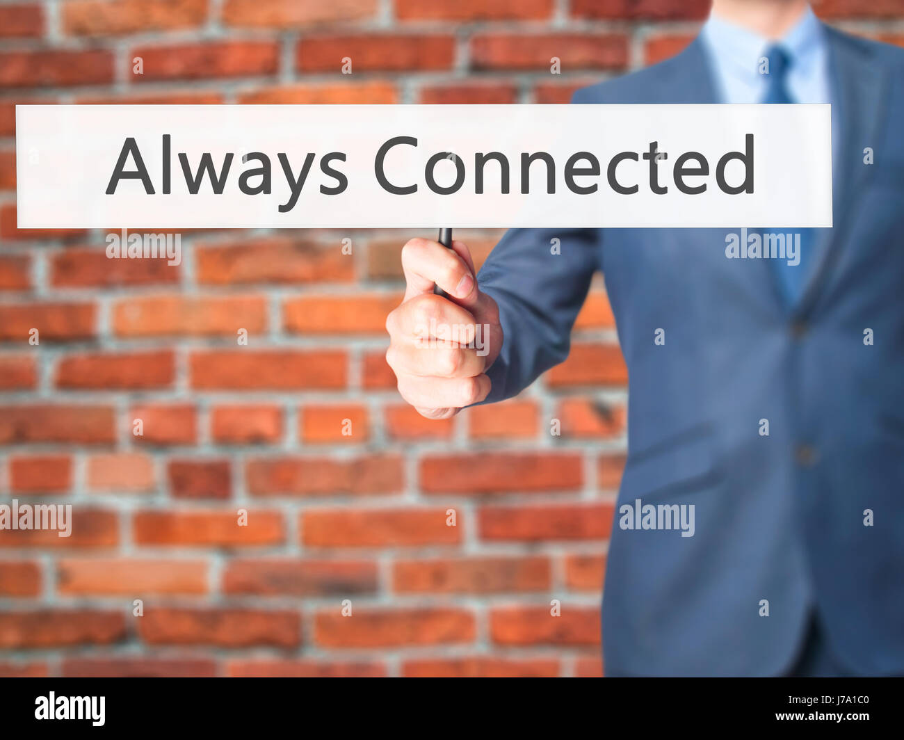 Always Connected - Businessman hand holding sign. Business, technology, internet concept. Stock Photo Stock Photo