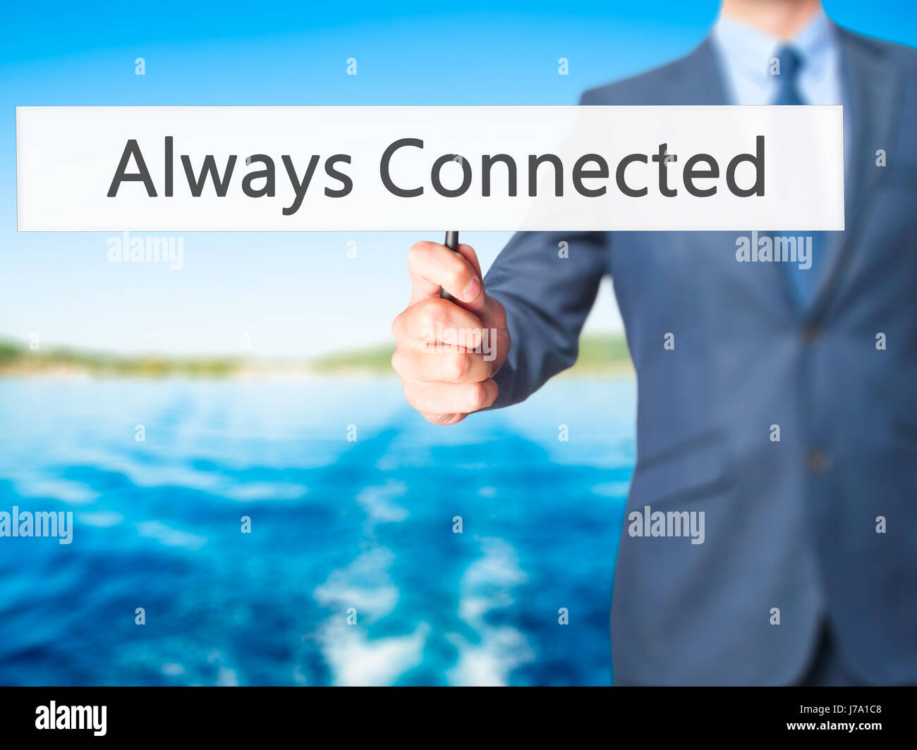 Always Connected - Businessman hand holding sign. Business, technology, internet concept. Stock Photo - Stock Image