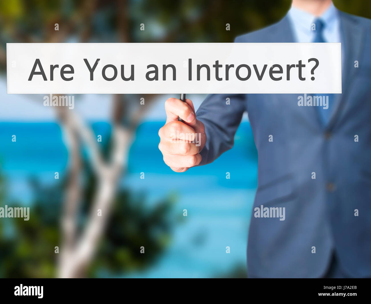 Are You an Introvert ? - Business man showing sign. Business, technology, internet concept. Stock Photo - Stock Image
