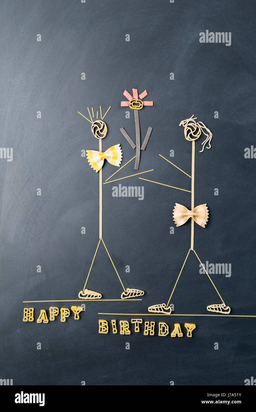 Pasta image with male and female likeness at birthday - Stock Image