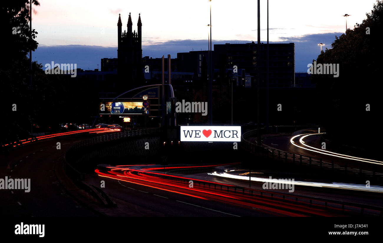 "A ""We Love Manchester"" sign on the Mancunian Way in Manchester, after the Manchester concert bomb - Stock Image"