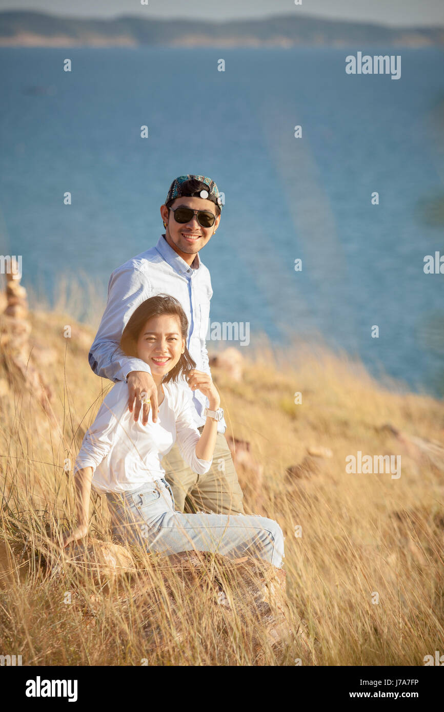 portrait of asian younger man and woman relaxing vacation at sea side happiness emotion - Stock Image