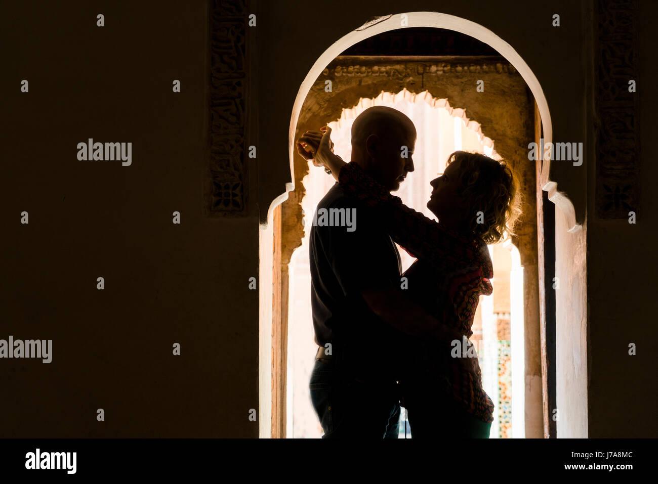 Morocco, Marrakesh, couple hugging in doorframe - Stock Image