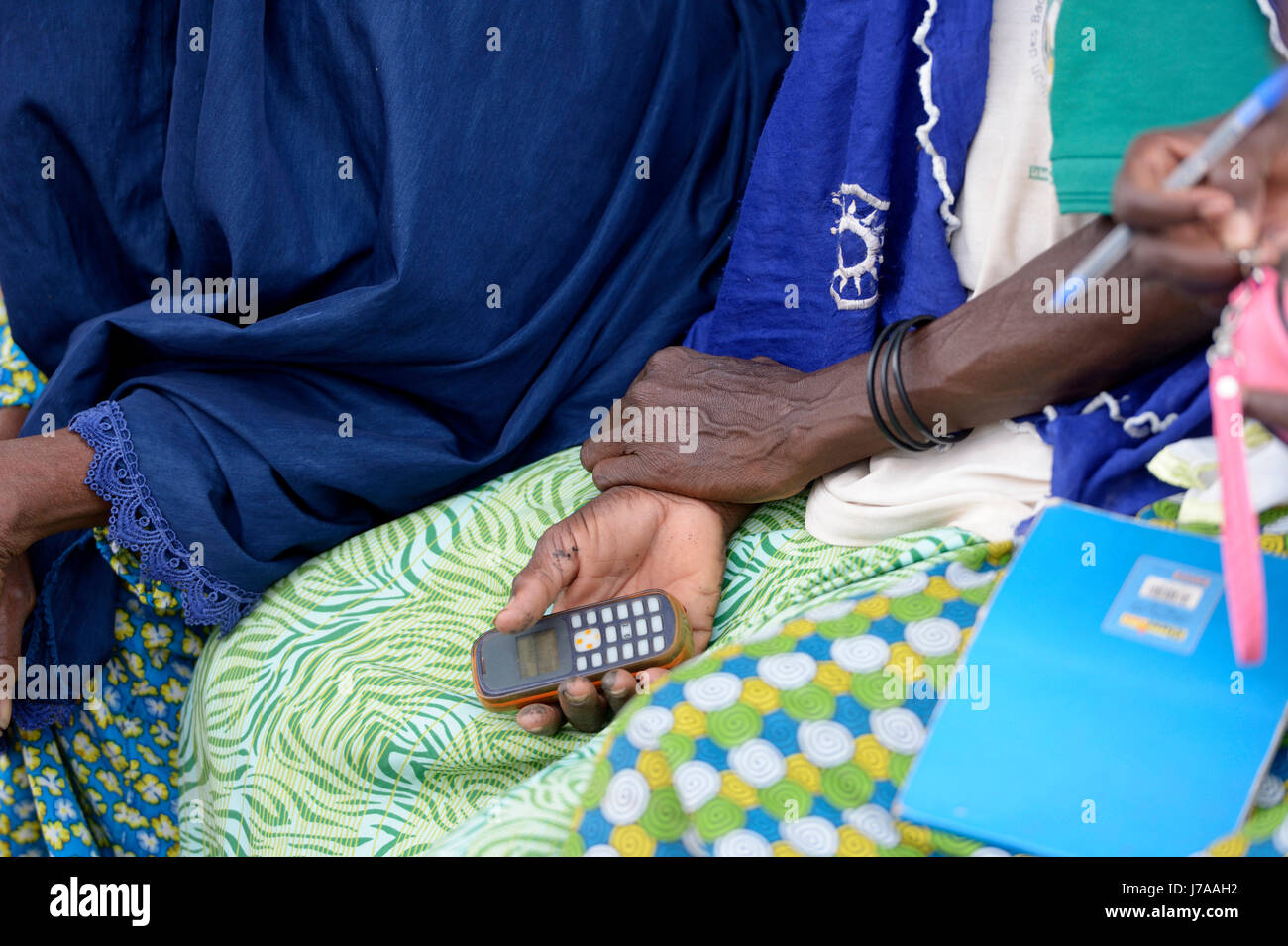 Burkina Faso, woman holding mobile phone - Stock Image
