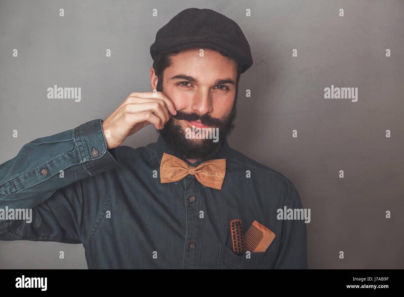 a6f778442e3 Portrait of bearded man wearing cap